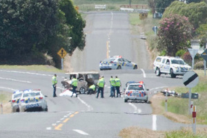 Through a heat haze, the horrific scene of a fatal crash in Taranaki, in which a van ploughed head-on into a group of motorcyclists on a charity toy run. Photo / Kevin Bone