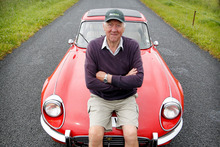 John Sansome and his red E-type Jaguar. Photo / Christine Cornege