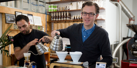Mike Murphy (right), with barista Sam Jarvis, says the new shareholder would ideally offer guidance on growth strategy. Photo / Greg Bowker