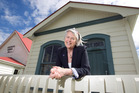 Kaukapakapa resident Carol Forsyth outside the library and community hall built in 1860. Photo / Natalie Slade