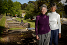 Sisters Janis Fairburn and Dinah Holman say the highway work is an intrusion into the cemetery. Photo / Greg Bowker