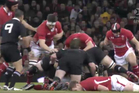 The Cardiff test was marred in the first minute when All Black hooker Andrew Hore (No 2) king hit Wales player Bradley Davies from behind. Below, he lies prone on the turf. Photo / Skysport