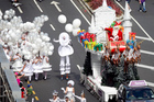 Excitement as the annual Santa Parade wends its way through downtown Auckland, with the star of the show prominent in his decorated sleigh. Photo / Natalie Slade
