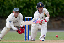 Wellington's Luke Ronchi sweeps the ball during the match against Auckland yesterday at Eden Park. Photo / Greg Bowker