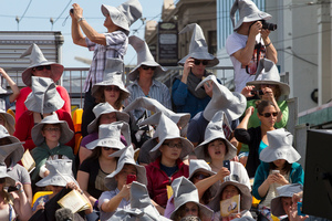 Fans wearing wizard hats along the red carpet during the World premiere of the Hobbit: An Unexpected Journey. Photo /  Mark Mitchell