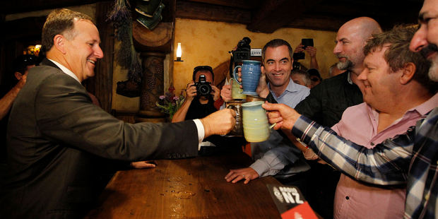 John Key shared a beer yesterday at Hobbiton's Green Dragon Pub in Matamata with actors (from right) William Kircher, Stephen Hunter, Graham McTavish and James Nisbet. Photo / Christine Cornege