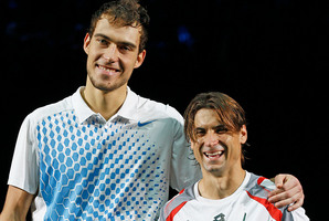 Jerzy Janowicz (left) defied the odds to reach the Paris Open final, where he lost to David Ferrer. Photo / AP