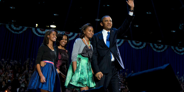 President Barack Obama holds hands with his youngest daughter Sasha, while 14-year-old Malia walks behind with her mum, Michelle.Photo / AP