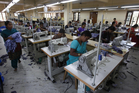 Indian workers sew at a garment factory on the outskirts of Hyderabad, India. Photo / AP
