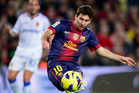 Barcelona's Lionel Messi is looking to become the first player to win the award four times. Photo / AP