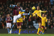 Arsenal's Mikel Arteta (right) and Villa's Christian Benteke battle for the ball in a game with few chances. Photo / AP