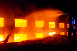 Bangladesh firefighters battle the fire at the garment factory outside Dhaka, Bangladesh. Photo / AP
