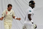New Zealand's Tim Southee, left, celebrates the dismissal of Sri Lanka's Angelo Mathews. Photo / AP