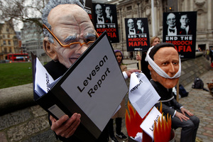 Protesters outside the building where the Leveson report was released reinforced the public outrage over the abuses and power of the press, especially in the Murdoch media empire. Photo / AP