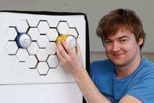 Ben de la Roche and his award-winning design 'Impress', an external refrigeration system. Photo / Mark Mitchell