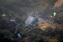 Three men died and one was seriously injured when the RNZAF Iroquois helicopter crashed near Pukerua Bay. Photo / Mark Mitchell
