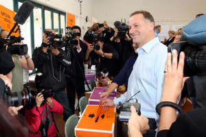 John Key votes in the Parnell District School on the day of the New Zealand General Election 2011.  Photo / Janna Dixon