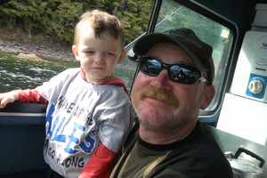 Barry Bethune with grandson Cole Bethune, 2, whose father Shaun died when the Extreme One capsized in Foveaux Strait in January. Photo / Supplied