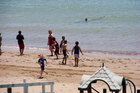 A group of children were happily playing in the water at Paihia, cooling off from the hot sun - then someone yelled: 