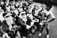 Wade Atiga witnessed 75 American Santas burst into the Child Cancer Society's Christmas party 23 years ago.