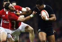 Julian Savea of the All Blacks fends off Alex Cuthbert of Wales during the international match between Wales and New Zealand. Photo / Getty Images.