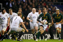 South Africa's Ruan Pienaar runs with the ball as England's captain Chris Robshaw, third left, moves across to attempt a tackle. Photo / AP