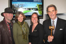 Jeff Dickie, left, and his wife Liz, with Bayleys Queenstown saleswoman Katharine Tomlinson and general manager and auctioneer David Murray. Photo / Tracey Roxburgh