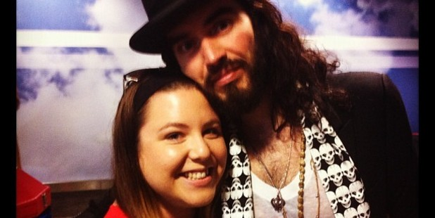 Fan Peta Falzon with comedian Russell Brand, who's in New Zealand for several shows. Photo / Supplied