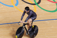 Eddie Dawkins cruises past the Olympic Rings after finishing the men's teams sprint qualifying at the Olympics. Photo / Mark Mitchell