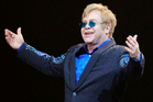 Elton John offended China by dedicating a song to a dissident artist. Photo/AP