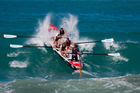 The champion Piha men's boat crew on their way to the national title at Midway Beach, Gisborne. Photo by Jamie Troughton/Dscribe Journalism.