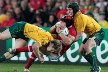  Leigh Halfpenny is tackled by Australia's James O'Connor (left) and Berrick Barnes during last year's Rugby World Cup bronze playoff. Photo / Natalie Slade