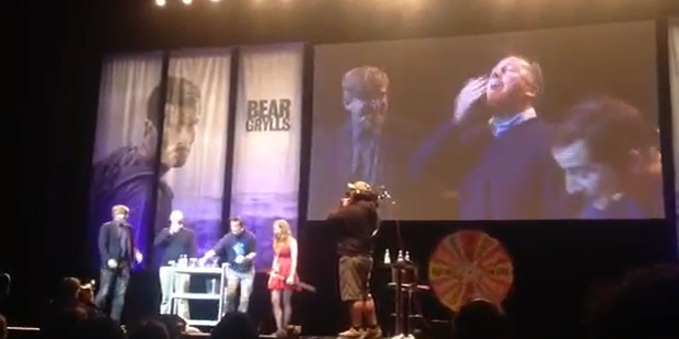 Prime Minister john Key eats bugs on stage with Bear Grylls during Grylls' one man show in Auckland. Photo / YouTube