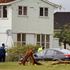 Police check the area and housing damage after a tornado hit the area of Hobsonville in West Auckland this morning.  Photo / Sarah Ivey