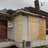 Houses are boarded up after a tornado hit the area of Hobsonville in West Auckland this morning. Photo / Sarah Ivey