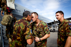 Departing NZDF members are farwelled by Deputy Commander Major Sydney Dewes NZDF at Honiara Airport, Solomon Islands. Photo / Dean Purcell