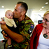 CSM John Spence with his wife Kathy Spence and his new grandson Daimhin Winslade age 4 months at Christchurch Airport.  Photo / Dean Purcell