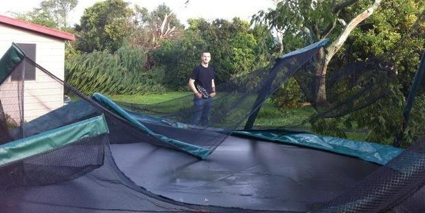Paul Dunn with his damaged trampoline. Photo / Paul Harper