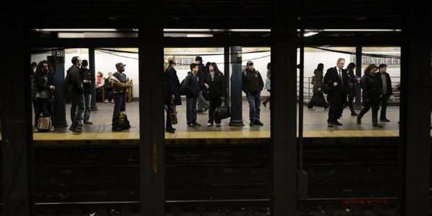 A man was pushed into the path of a subway train in New York yesterday. Photo / AFP