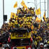 Surrounded and followed by fans, Barcelona's players celebrate aboard an open-top bus during a parade after winning the Ecuadorean first division soccer tournament in Guayaquil, Ecuador. Photo / AP