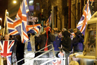 Loyalists confront Police Service of Northern Ireland officers as they try to force their way into Belfast City Hall when tempers flared about a week ago. Photo / AP