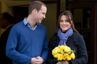 Britain's Prince William stands next to his wife Kate, Duchess of Cambridge, as she leaves the King Edward VII hospital in central London. Photo / AP