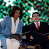First lady Michelle Obama, left, and Rico Rodriguez, read 'The Night Before Christmas' to children during the 90th annual National Christmas Tree Lighting ceremony at the White House in Washington. Photo / AP