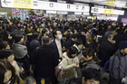 Crowds gather at Sendai railway station in Miyagi Prefecture after trains were halted following a strong earthquake off the coast of northeastern Japan. Photo / AP