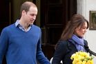 Britain's Prince William stand next to his wife Kate, Duchess of Cambridge as she leaves the King Edward VII hospital in central London. Photo / AP