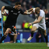 Cory Jane of New Zealand is marshalled by Mike Brown of England during the QBE International match between England and New Zealand. Photo / Getty Images.
