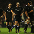 The All Blacks look dejected after defeat during the QBE International match between England and New Zealand. Photo / Getty Images.