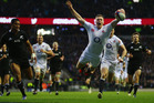 Chris Ashton of England goes over to score a try during the QBE International match between England and New Zealand. Photo / Getty Images.