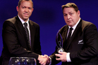Steve Hansen (R) the head coach of New Zealand receives the Team of The Year award from Oregan Hoskins the President of SARFU. Photo / Getty Images.