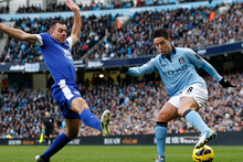 Manchester City's Samir Nasri, right, fights for the ball against Everton's Darron Gibson during their English Premier League soccer match. Photo / Getty Images.